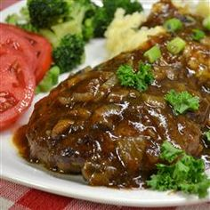 """Hamburger Steak with Onions and Gravy: An easy-to-make classic featuring tasty hamburger 'steaks' smothered in gravy and onions. Traditionally served with hot white rice or potatoes, it's a great way to dress up a pound of ground beef and you probably have all the ingredients on hand!""""  4 1/2 of 5 Stars, 1422 Reviews @ Allrecipes. Note: Patties: Egg, breadcrumbs, onion powder, garlic powder and Worcestershire sauce. Gravy: Beef broth and sherry."""