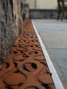 Seattle-based Iron Age Designs Ruqaiyah 2 recycles engine blocks and brake drums to create cast-iron drainage grates like no other Detail Architecture, Landscape Architecture, Urban Landscape, Landscape Design, Drainage Grates, Trench Drain, Drain Cover, Design Jardin, Iron Age