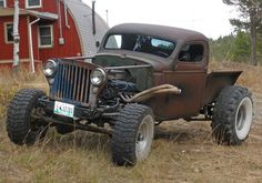 Retro Creation:  Jeep YJ frame chopped '39 Chevy cab, '50s Willys grill, '39 Chevy bed and a 500ci V8 with a TH400 tranny,Airbag w/ Custom 4-Link (BDS Link Ends and Bushings), 33'' X-Terrains and 40'' Swampers (geared to compensate)
