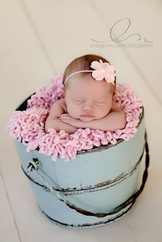 baby in vintage pail + flower attached to head... always a crowd pleaser ---- i love the angle... shoot from above