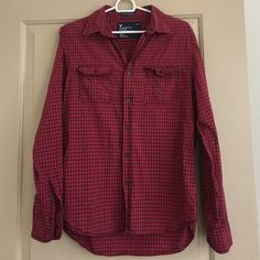 Men's AEO Checked Shirt Men's red checked button down long sleeve casual shirt by American Eagle Outfitters. Size Medium - tag says vintage fit. 100% cotton, comes with 2 spare buttons American Eagle Outfitters Shirts Casual Button Down Shirts