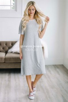 Cute, comfy and easy to wear! This go-to, light weight dress is perfect for running errands and lunch dates!Light graydress features thin white stripes, short flutter sleeves and a higher neckline.