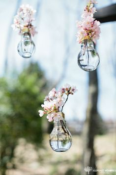 It's all in the details! These hanging flowers vases make are perfect wedding decor.