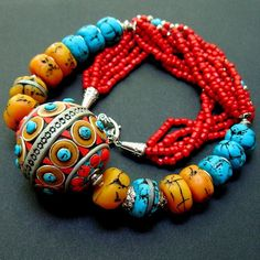 Necklace |  Svetlana Gracheva.  Clay polymer is the center piece.
