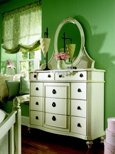 Inviting, casual and comfortable easily describes Emma's Treasures from Lea Furniture. Traditional styling mixed with a cozy time-worn appearance creates a collection of youth furniture sure to please any age girl. The distressed vintage white color finish, antiqued pewter-color hardware, the use of cane and crystal-cut mirrors all help create the shabby chic appeal of this group.