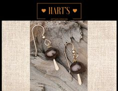 "~10 mm Black Pearl 14K Gold Earrings~  Moon Shadow 10 mm black cultured pearl on 14kt gold-filled 20 gauge French style ear wires.  Dangle hangs 3/4"".  Follow this link to purchase these black pearl cultured pearl 14kt earrings:  www.PearlGemstoneArtisanJewelry.com"