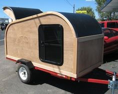 Tear Drop Trailers Designed for Today's Campers    Custom built teardrop camper/trailer reminiscent of the original 1930s designs of teardrop campers, updated for today's modern camper. This is a custom built wooden teardrop camper made out of hickory wood, but also available in almost any type of wood, including mahogany. Designed for today's taller campers with 8 feet of interior leg room and plenty of interior open space.