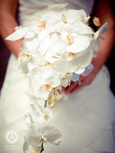 Wedding bouquet - white orchids. Photography by Tatiana Valerie, Artvesta Studio. www.artvestastudio.com #wedding pictures #romantics #wedding poses #wedding couple #bridal pictures #New York wedding #Artvesta Studio #wedding photography