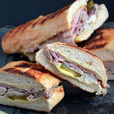 The Cuban Sandwich features buttery bread, honey ham, Cuban pork (which is made in the slow cooker), Swiss cheese, pickles,  mustard! Yum!