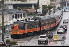 Santa Cruz & Monterey Bay Railway. This is a great picture of trains with cars.