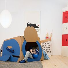 Such cute new cardboard playhouses like this one that lets kids hide out in the belly of a whale.