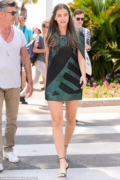 Leaving them green with envy: The Victoria's Secret beauty later changed into a black and emerald one-shoulder mini-dress as she arrived at the iconic Hotel Martinez