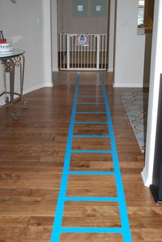 We set up train tracks all through the house with blue duct tape leading to the different train stations (i.e. potty station, diaper bag depot, food station, drink station, sweets station, gift station, coloring station, play station, bubbles station)