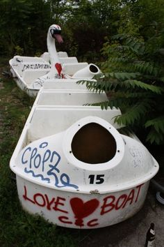 The Spreepark's famous swan boats -- now covered in graffiti -- are dotted...