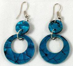 These are beautiful shell hoop earrings. They come in a blue colour and measure at 5.5 cm.