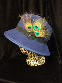 Wool felt hat with peacock feathers by Katherine Livengood
