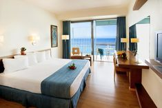 Covering up to 24 sqm, the superior room features one bedroom, bathroom with bathtub and a breathtaking sea view. Double Room, Double Beds, Greece Hotels, Superior Room, Greece Holiday, One Bedroom, Swimming Pools, City, Twin Beds