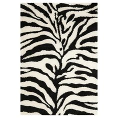 Anchor your foyer, living room, or master suite with this eye-catching shag rug, showcasing a zebra-print motif in ivory and black.  Pro...