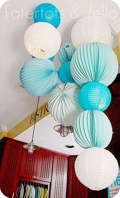 paper lanterns from the ceiling via @jenjentrixie so fun & festive!