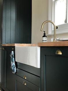 Farrow & Ball Inspiration - Cabinets in deep dark Studio Green.