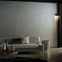 Tiny pieces of hexagonal-shaped plywood were used to imprint an outline onto paper-backed vinyl. For added rich tones, a light-reflective emboss has been used. Available from www.silkinteirors.com.au #wallpaper #wallpaperforwalls