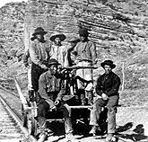 WORKERS ON THE TRANSCONTINENTAL RAILROAD  The building of the transcontinental railroad was perhaps the greatest engineering feat of the 19th century. Initially hired for manual labor only, Chinese workers proved able at skilled work - serving as masons, tracklayers and foremen. Credit: Denver Public Library, Western History Collection (Neg. #x-21513)
