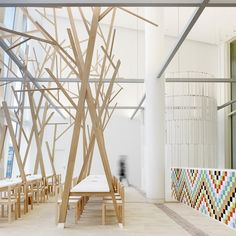 The tree-like sculptures growing out of the tables in this canteen by Spanish architects Estudio Nômada are meant to remind diners of eating outdoors.