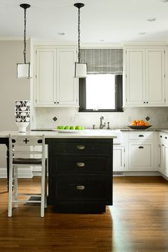 Simple, sleek kitchen that still has a traditional feel. Barstools reminds me of my quatrefoil chairs!