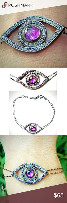 "Amethyst Evil Eye Bracelet in Sterling Silver Beautiful double chain Amethyst Evil Eye Bracelet in Sterling Silver. Amethyst center stone with amethyst crystal accents. Adjustable length from 6'-7.5"". Perfect condition. Boutique  Jewelry Bracelets"