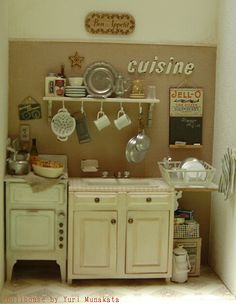 Miniature dollhouse kitchen - image for inspiration, great staging (e.g. objects tucked in under dish rack, decorative plaques on the wall)