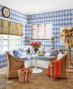 """Designer Emily Painter resuscitated her 1,300-square-foot space. All changes are cosmetic too because this is a rental! """"While trying to brighten the place and make it feel like an island home, I was also wanting to visually enlarge it and create rooms within rooms…"""" #coastal #boho #patterns #wallpaper #colorful #decorideas #southernliving Woven Shades, Tulip Table, Wicker Tray, Banquette Seating, Kitchen Nook, Kitchen Ideas, Kitchen Decor, White Wicker, Blue Wallpapers"""