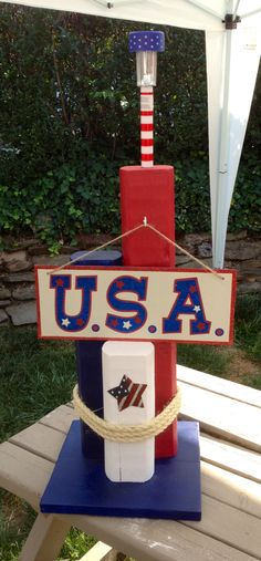 Made with landscape timbers and solar light  $30.00