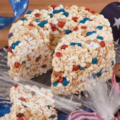 Popcorn Cake Recipe - caramel marshmallow flavored. 1 package (16 ounces) miniature marshmallows  20 caramels  1/4 cup butter, cubed  10 cups popped popcorn  1-1/2 cups salted peanuts  1 cup red, white and blue milk chocolate M's  TasteofHome
