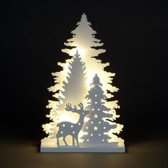 This LED lit Warm White Wooden Carved Trees and Deer ornament is sure to brighten up your home this Christmas. Requires 3 x AA batteries, not supplied. Christmas Tree Crafts, Christmas Deer, Holiday Tree, Christmas Lights, Holiday Crafts, Christmas Holidays, Christmas Decorations, Wooden Xmas Trees, Deer Ornament
