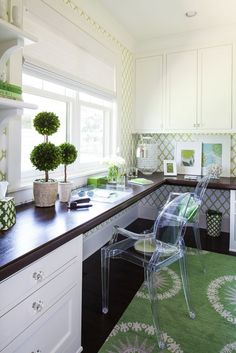Fun green and white colors dark wood top desk and lucite chairs | Martha O'Hara Interiors