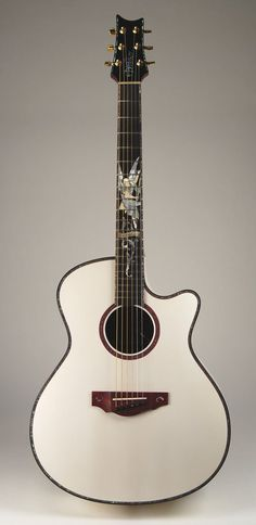 warrior - custom shop acoustic. white gabriel concert guitar.