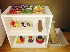 Puzzle shelf of lessons with work mat for toddlers from Simplynaturalmom.com