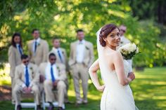Bride with groomsmen; another pic with groom with bridesmaids.  Relaxed kind of pose.