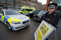 Chief Superintendent John O'Hare with a hearse, police car, ambulance and taxi which were lined up along Piccadilly Gardens to remind revellers of the consequences of their decisions. The vehicles took their place at the busy city centre location on 'Mad Friday' (December 19 2014) to encourage those going out on the busiest night of the year to make responsible choices whilst enjoying the festivities. www.gmp.police.uk