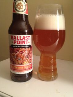 Ballast Point Grapefruit Sculpin AIPA is 7 ABV and 70 IBU.  The appearance is orange amber with a large head and the nose pine hop and fresh grapefruit.  The palate is sweet malt and bitter pine citrus hop in perfect balance.  That addition of grapefruit well compliments the hops and lends a bright fresh fruit note.  The big west coast hop profile and grapefruit could have been a mouth puckering hop bomb but it's so refrained.  Mouthfeel is creamy but ultimately drinkable.  This is top…