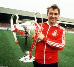 Former Forest boss Clough holds the European Cup after winning it for the first time in 1978-79