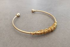 Excited to share the latest addition to my shop: Gold Bracelet Stacking Bangle Gold String Bracelet Gold Cuff Spiral Bracelet Gold Bangle Wire bracelet Bridesmaid Bracelet Gift # Thin Gold Bracelet, Gold Bangles, Diamond Bracelets, Bangle Bracelets, Geometric Necklace, Triangle Earrings, Hamsa Jewelry, Etsy Jewelry, Brass Jewelry