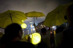 Pro-democracy protesters rise their yellow umbrellas, the symbol of the Occupy Central movement, as they march to the government headquarters two days before the first anniversary of the Occupy Central civil disobedience movement, in Hong Kong, China September 26, 2015. REUTERS/Tyrone Siu