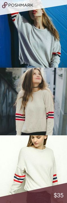"""Brandy Melville Veena Sweater RARE tan veena sweater with blue and red stripes. Hard to find sweater. Used but good condition. Fits up to a medoum, brandy sizes all clothing """"One size fits most"""" Brandy Melville Sweaters Crew & Scoop Necks"""
