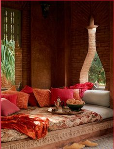 I really like the low-lying...sofa/bed + awesome color combinations.