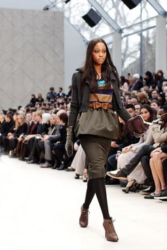Burberry forecasts cute feminine details such as the bow-tied cinched waists, ruffles, fitted outerwear and hues of blues/greens/oranges this Fall/Winter 2012 http://www.thesartorialist.com/photos/burberry-fallwinter-2012/
