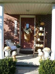 autumn front porch - I like the use of an old ladder...I may have to find one at the thrift store!