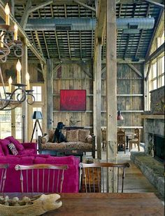 Re-purposed barn into a man cave.. minus the pink couch