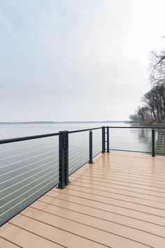 Cable Railing offers the perfect combination of safety railing and an unimpeded view for decks overlooking the water or other stunning views! Balcony Railing Design, Deck Railings, Deck Design, Balustrade Balcon, Lake Landscaping, Deck Makeover, Cable Railing, House Deck, New Deck