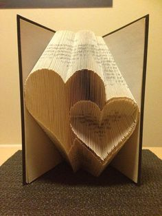 Book folding pattern for 2 Hearts ~ Love ~ Romance ~ Anniversary ~ Wedding +FREE tutorial This pattern enables the folder to create the pattern pictured in to a book. Its not as complicated as it looks! the res. Folded Book Art, Paper Book, Paper Art, Paper Crafts, Cut Paper, Paper Clay, Origami, Old Book Crafts, Pattern Pictures